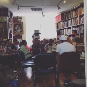 Book dealers learning about book auctions in Turkey.